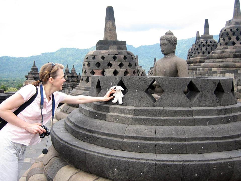 07preparingkids - Laurel Watjen of Washington state traveled with her daughterÕs stuffed bunny, April, on a two-week trip to Indonesia. Here, Watjen places the bunny by a statue at Borobudur, the famous 9th century Buddhist temple in Central Java, Indonesia. (Laurel Watjen)